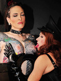 Obedient leashed tattooed tranny gives pleasure to her dicky domina and gets use