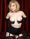 Good looking aged porn diva Nina Hartley in black lingerie dildos her mature pus