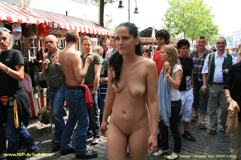Naked woman walking in the street