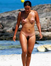 Completely naked girls and their boyfriends having fun on nudist beach