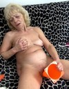 Hot blooded lesbian grannies spread their legs and share long black dildo