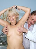 Aged doctor uses speculum to take a look at blonde mom's vagina in his office