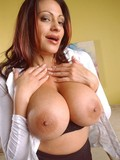 This hot middle aged woman is very proud of her sexy huge boobies and juicy ass