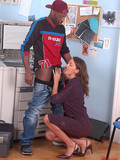 Sexy legged office brunette takes black visitor's juicy cock in her hungry mouth