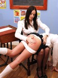 Uniformed schoolgirl dressed in black and white gets spanked by her classmate
