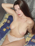 Pretty amateur doll was recorded in the nice black pantyhose and white bra