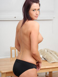 Brunette kitty with beautiful pretty small puffy tits poses in black panties