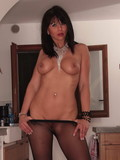 Playful MILF beauty with perfect juicy boobs strips down to her pantyhose