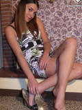 Leggy breathtaker Valentina in nice short dress  kicks off her shoes and displays her bare feet