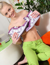 Petite blonde-haired teen angel with small tits goes topless with smile on her face