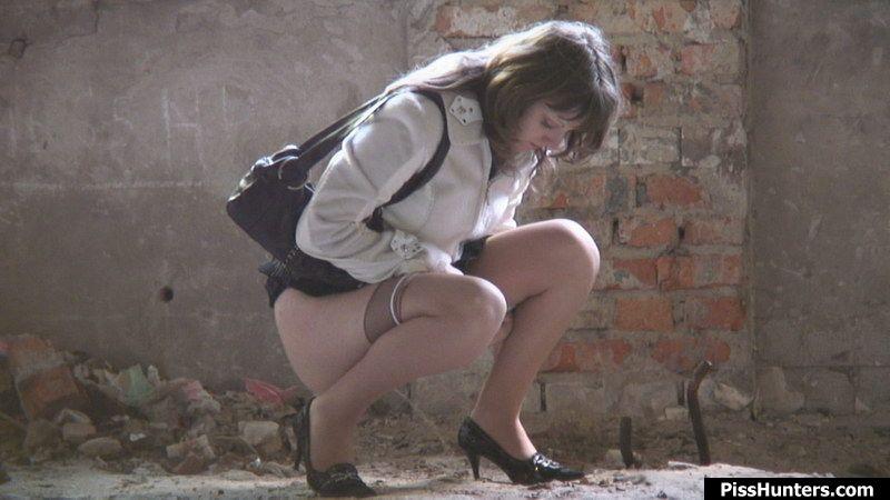 Girl peeing in skirt