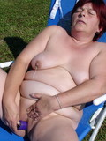 Fat granny masturbates in the sun by the pool then has sex with horny boy