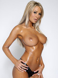Tall leggy blonde pornstar Amy Reid demonstrates her perfect big oiled melons