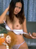 Honey brunette Asian doll baring her peachy breast and tight soaking pussy