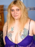 Ugly thick tattooed fem with huge breast and pierced nipples servicing her twat