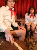 Russian scout girl in pantyhose removes her skirt to be spanked by her angry mate