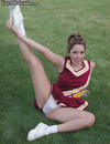Cheerleader girl pulls off her white panties to show her snatch outdoors