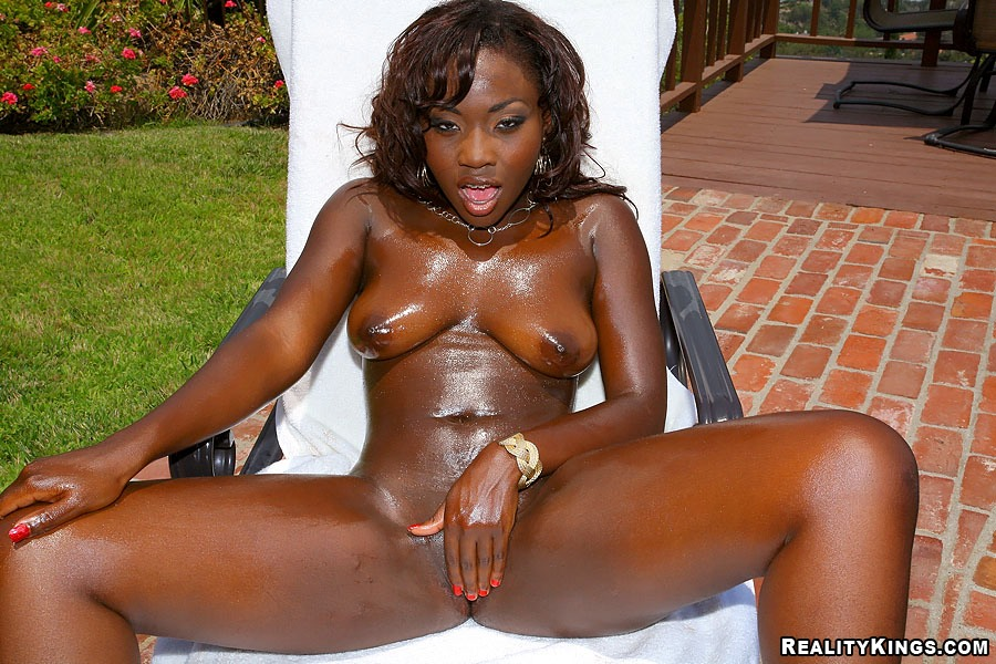 Oiled black slut gets her wet chocolate pussy stuffed full of big ...