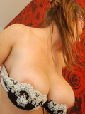 Elegant lingerie lady in mask pulls down her big size bra to show her heavy tits