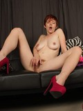 Playful Ryanne Redd spreads her hairy pussy lips and shows her pink hole