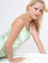 Angelic blonde in black high heel shoes and light green nighty  poses for you