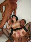 Brunette mom in stockings shows her pink cunt as she gets ass fucked in a threesome