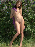 Petite virgin with tiny tits and neatly trimmed bush gets naked in the shadow of a tree