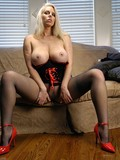 Blonde gets her big boobies out then masturbates with her pantyhose on