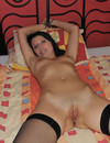 Attractive shaved pussy bondage girl Amy in stockings and shoes shows her naught