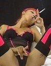 Lingerie-clad lady Nadia with pink hair gets pleasure smoking a cigarette