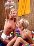 Two sexy clothed blondes get wet and spread their legs for each other for fun