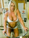 Flirtatious long haired muscular blonde flashes her huge tits at the gym