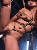 The bound body of this horny chick suffers from ropes and perverted guy