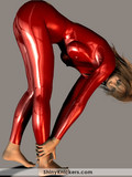 The big butted girl in shiny outfit looks horny, turning on and very flexible