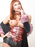 Lovely redhaired tranny with huge globes removes off her tight leather shorts an