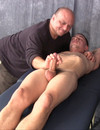 Unwanted slow hand job from a clothed older man for a naked younger dude