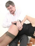 Nasty aged man fiercely spanks booty of sultry fem in black dress and nylon stoc