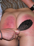 Young brunette haired chick gets her ass ferociously spanked with hairbrush
