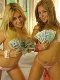Two playful latin twin sisters remove their white shorts and pose in thong panties