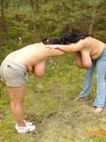 Two topless chubby brunettes with giant saggy tits do exercises in the woods