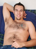 Black haired dude James with hairy tattooed chest gets nude and polishes his coc