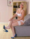 Pretty blonde Hannah in snow white lingerie wears blue high heel shoes