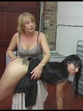 Bare assed brunette gets mercilessly spanked by very angry blonde lady