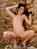 Beautiful smooth skinned slim brunette Nella takes off her bikini and poses nake