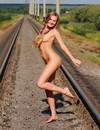 Pigtailed blond girl Alena fills no shame to pose totally naked in the open place