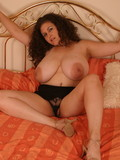 Flirty long haired amateur woman in black skirt Denise Davies displays her massi
