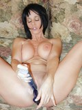 Busty brunette uses two sex toys on her shaved pussy and still can't get enough