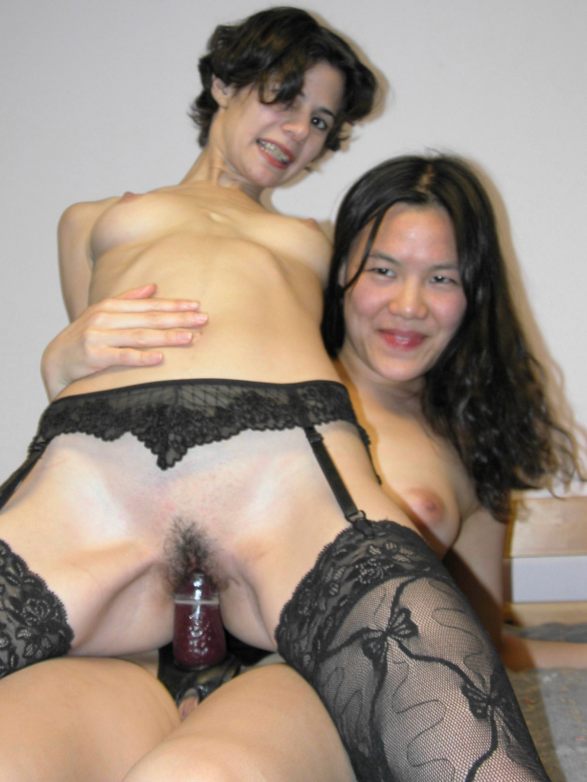 Skinny lesbian amateur brunette in black stockings gets her tight pussy  strapon fucked