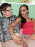 Lucky four-eyed guy gets jerked off by long legged teen cutie on the couch