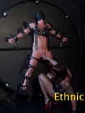 Black mistress in fishnets plays with helpless white slave's balls and cock